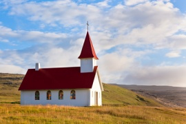 Typical Rural Icelandic Church under a blue summer sky